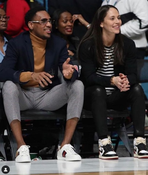 Monté Morris with a date watching a basketball game