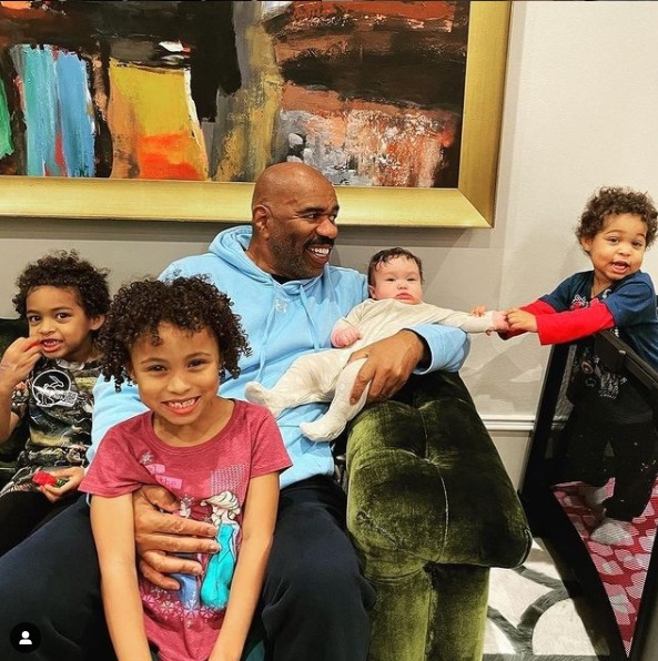 Steve harvey playing with his grand children