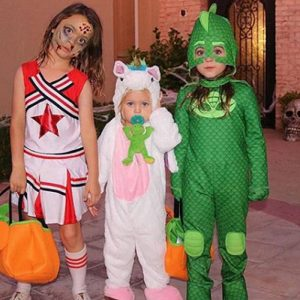 Noah Green with his two siblings wearing dress for Halloween. The dress cause a public uproar but Megan supported her son.