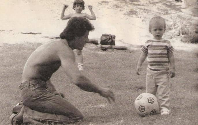 Seargeoh Stallone childhood photo with his father sylvester playing football