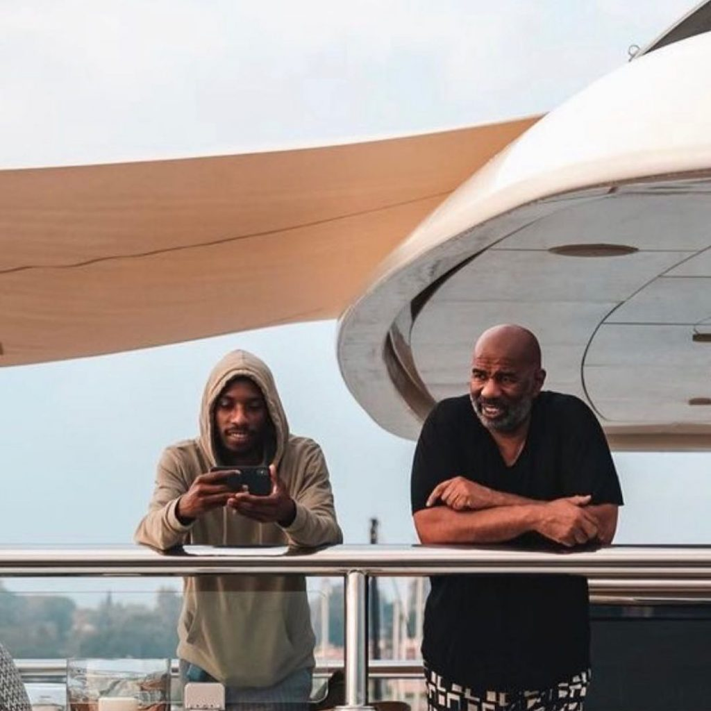 Steve Harvey with his son Broderick Harvey Jr in a Yatch
