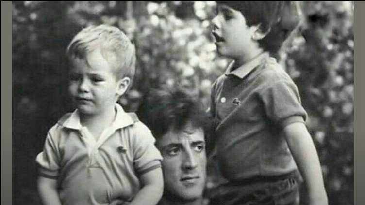 Sylvester Stallone carrying his two sons sage and seargeoh on shoulder.